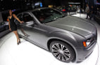 Image: Model next to Chrysler 300 S on display at New York International Auto Show
