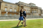 Image: Britain's Prince William and Catherine, Duchess of Cambridge, walk together in Buckingham Palace in central London