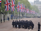 Image: Police officers walk down The Mall before the wedding of Britain's Prince William and Kate Middleton in central London