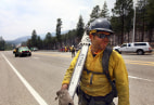 Image: A fire crew member is seen as fire crews are deployed in order to attack hotspots from the Las Conchas wildfire near Los Alamos, New Mexico