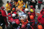 Image: Rescue workers carry earthquake survivor Mehmet Zengin to an ambulance after he was found in a collapsed building in Van, eastern Turkey