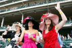 Image: Stephanie Peele, Laurie Gillespie, and Deborah Williamson cheer on the horses during the first race at Churchill Downs in Louisville
