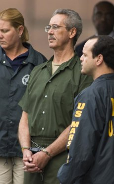 Image: File photo of Allen Stanford leaveing federal court in Houston