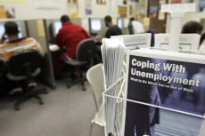 Image: Unemployment brochures are seen on display at the employment training facility, JobTrain, in Menlo Park, Calif.,
