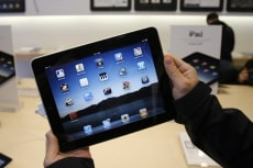 Image: Customer uses an Apple iPad