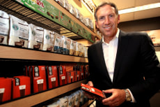 Image: Starbucks CEO Howard Schultz holds up a new Via coffee product at the Starbucks corporate headquarters in Seattle, Washington