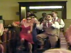 Image: Wedding party dancing down the aisle