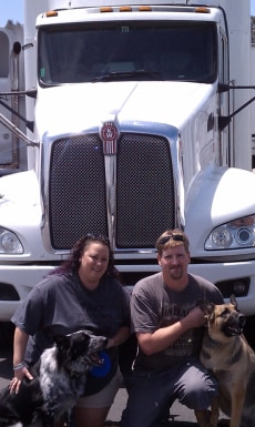 Image: Christy and Christopher Fidura, pictured in front of their truck with their dogs, Flash and Summer