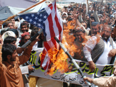 Image: Pakistanis burn the U.S. flag in condemnation of  bin Laden's killing