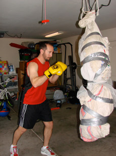 Image: Kevin Cotter punching a punching bag crafted from his ex-wife's wedding dress