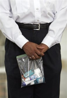 Image: Security official holds a bag of liquid and gels