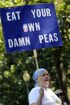 Image: A woman holds a sign with a message for President Barack Obama.