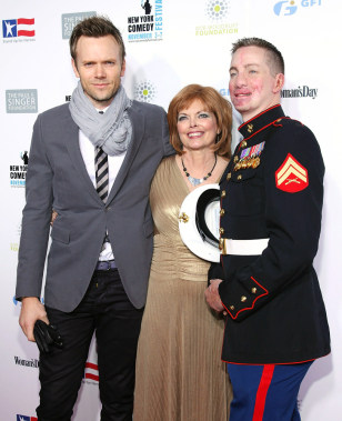 Image: Joel McHale at Stand Up for Heroes 2010 with retired Marine Cpl. Aaron Mankin, right, and his mother Diana Phelps