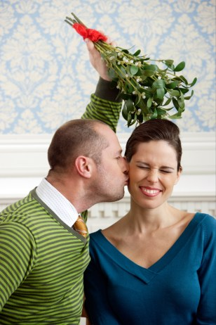 Image: Stock representation of mistletoe kissing