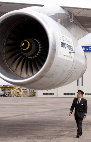 Image: Pilot checks plane before flight using biofuel