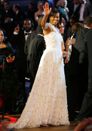 Image: First lady Michelle Obama waves after dancing with President Barack Obama at the Neighborhood Inaugural Ball in Washington