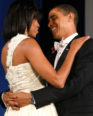Image: US President Barack Obama dances with First Lady Michelle Obama