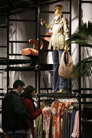 Image: Customers browse clothes at Mango in New York