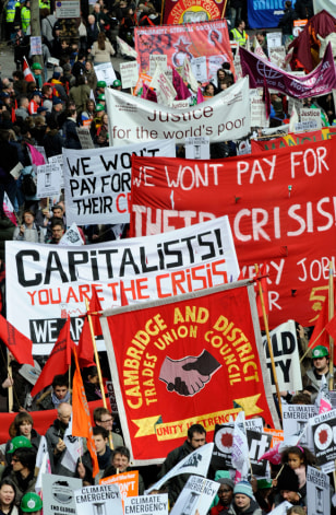 Demonstrators march ahead of next week's G20 summit in London