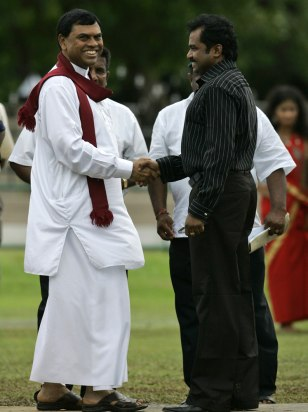 Image: Vinayagamoorthi Muralitharan shakes hands with Basil Rajapaksa