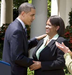 Image: Barack Obama shakes hands with new Surgeon General Regina Benjamin