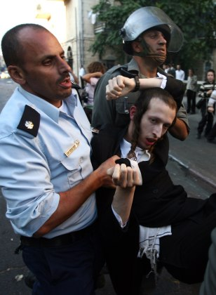 Image: Police arrest an ultra-Orthodox Jew in Jerusalem