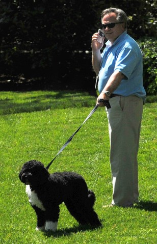 Image: White House Horticulturist Dale Haney walks with Bo outside the White House