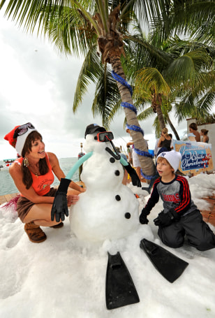 Image: Cyndi Livingston and her grandson play in manmade snow in Florida.