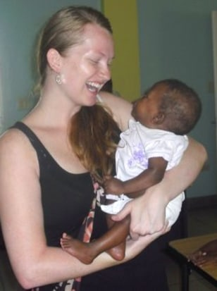 Image: Molly Hightower and a Haitian orphan