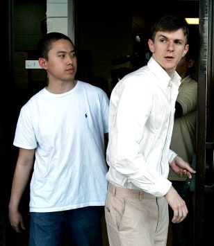 Image: James O'Keefe, right, and Stan Dai leave St. Bernard Parish jail