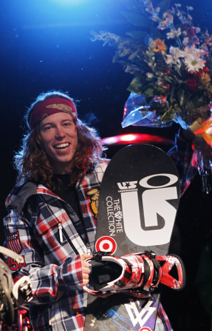Image: Snowboarder Shaun White of the U.S. celebrates being named to the 2010 U.S. Olympic Halfpipe Team in Park City