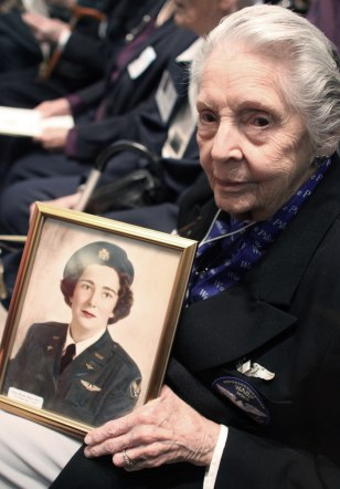 Image: June Bent holds photo of fellow pilot and friend Doris Duncan Muise
