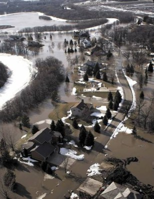 Image: The Red River floods properties Wednesday in the area of Wild Rice, N.D., south of Fargo.