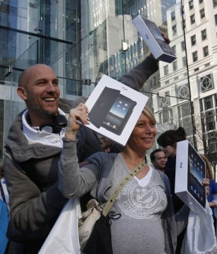 Image: Couple with their newly purchased iPads