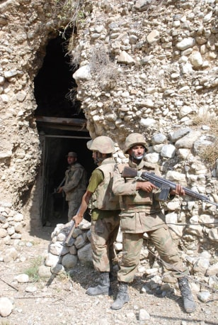 Image: Pakistan army outside of a cave allegedly used by militants in Taliban stronghold