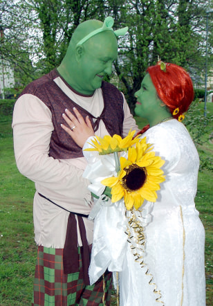 Image: Vivian and Tracey Williams dressed as Shrek and Princess Fiona
