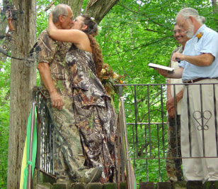 Image: Marvin Hunter and Kim Silver in a tree stand
