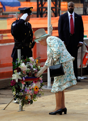 Image: Queen Elizabeth II of England lays a wreath as she pays tribute to the victims of the Sept. 11 attacks during a visit to ground zero