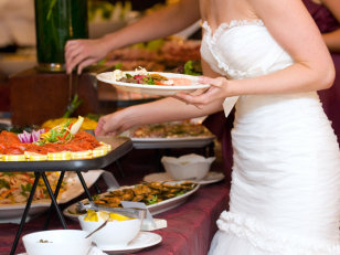 Image: Bride getting food from buffet