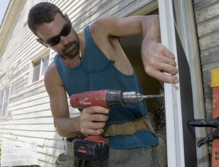 Image: Man installing door
