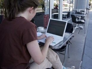 Image: Woman using free wi-fi at coffee shop