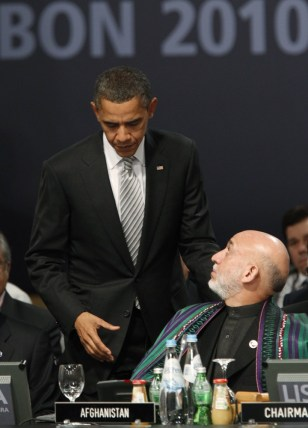 Image: U.S. President Barack Obama greets Afghanistan's President Hamid Karzai at the NATO Summit in Lisbon