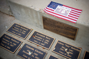 Image: The plaques placed in memory of former students killed in the wars in Afghanistan and Iraq as seen in the memorial garden of Buchanan High School in Clovis, Calif.
