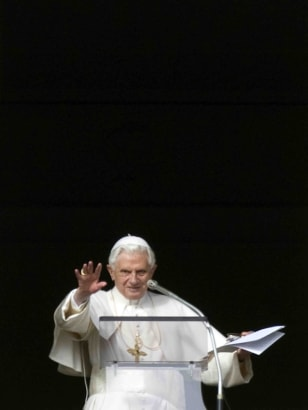 Image: Pope Benedict XVI delivers his blessing during the Angelus noon prayer