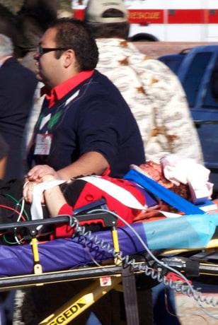 Image: Daniel Hernandez assists Gabrielle Giffords