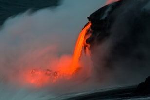 Image: Lava entering water at dusk, Hawaii's Big Island