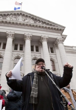 Image: Michael Moore addresses a crowd Saturday at the state Capitol in Madison, Wis.