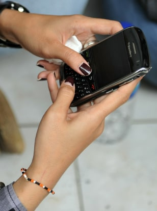 Image: A woman uses her BlackBerry.