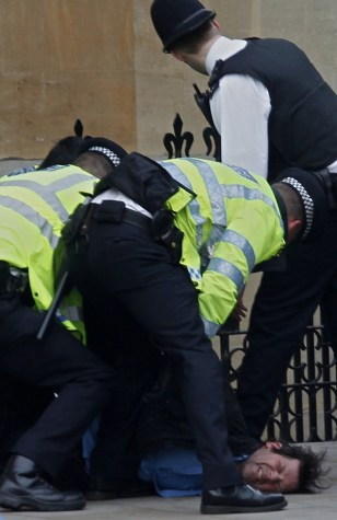 Image:Police officers arrest a man as he tries to get into Westminster Abbey in London before the royal wedding.