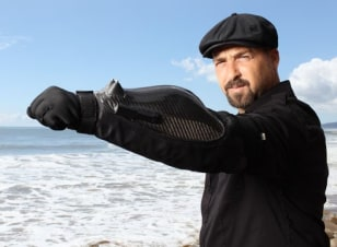 Image: This crime-fighting armored glove has a wrist-mounted stunner and a video camera built in.
